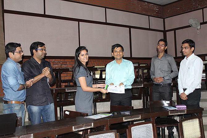 Anurag Singhal, fourth from left, receives a prize for 'Czars of online bazaar'