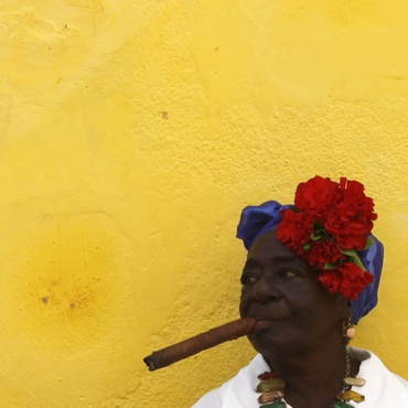A lady enjoys a cigar in Cuba