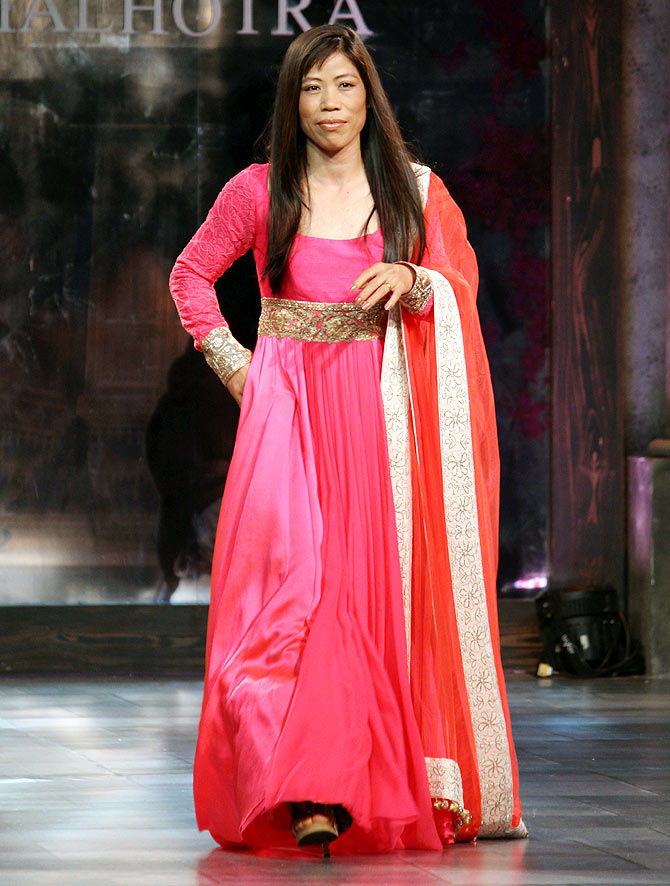 Indian Olympian, boxer MC Mary Kom walks the ramp for Manish Malhotra at Shabana Azmi's NGO Mijwan Welfare Society fashion show in Mumbai in September 2012