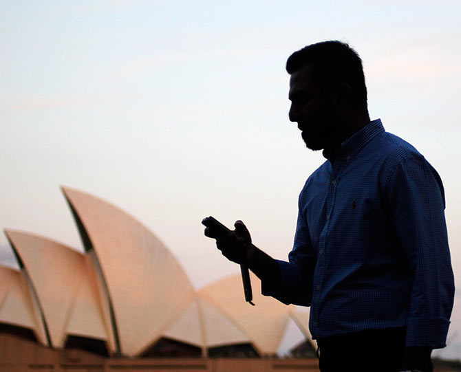 Image result for lonely man in front of  sydney opera house