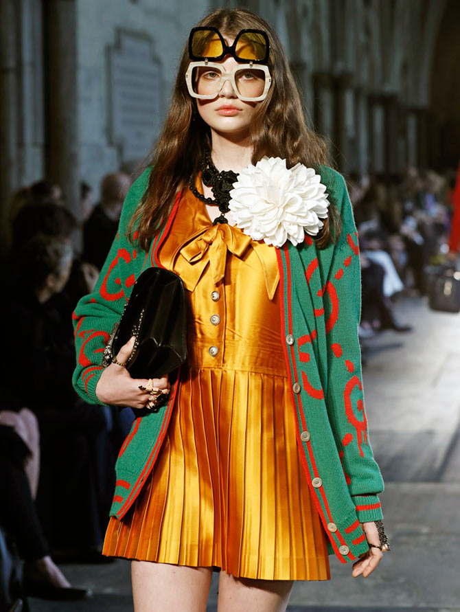 8fe34f1ec65943 Photograph  John Phillips Getty Images. IMAGE  We couldn t take our eyes  off this gorgeous golden pleated mini with a Gucci sweater over.