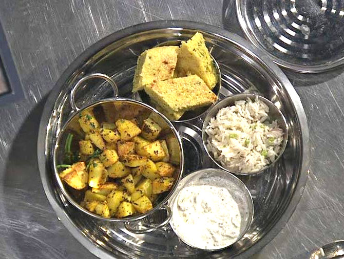 Latest News from India - Get Ahead - Careers, Health and Fitness, Personal Finance Headlines - Veg Thali Recipe: Potato Curry, Peas Pulao, Dhokla, Raita and Rotli
