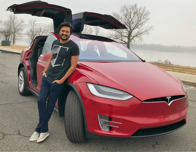 Riteish Deshmukh's with his Tesla Model X.