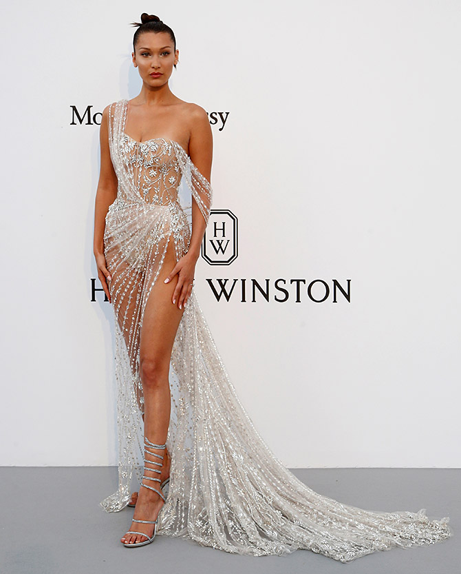 d25c1667dd99 Dressed in a see-through gown created with stunning crystals, the  Victoria's Secret model left little to the imagination at the amfAR's  Cinema ...