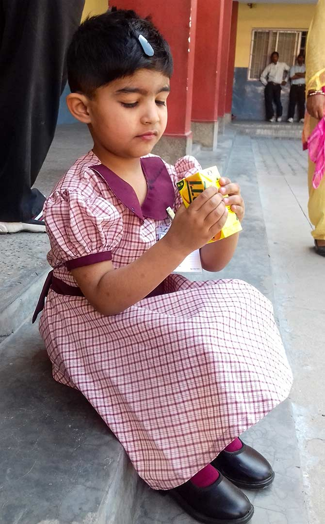 Latest News from India - Get Ahead - Careers, Health and Fitness, Personal Finance Headlines - In pics: Tiny tots enjoy first day at school