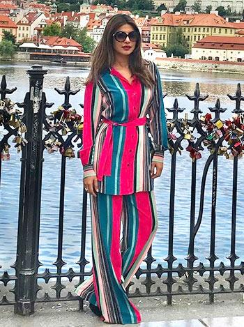 Image result for Priyanka sports her pyjama suit in Prague]