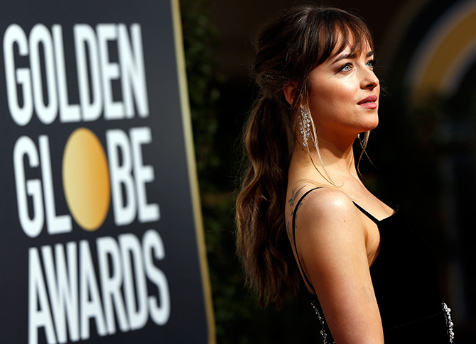Hollywood star Dakota Johnson on the Golden Globes red carpet wearing Nirav Modi' Nirav Modi's cascade earrings. Photograph: Mario Anzuoni/Reuters.
