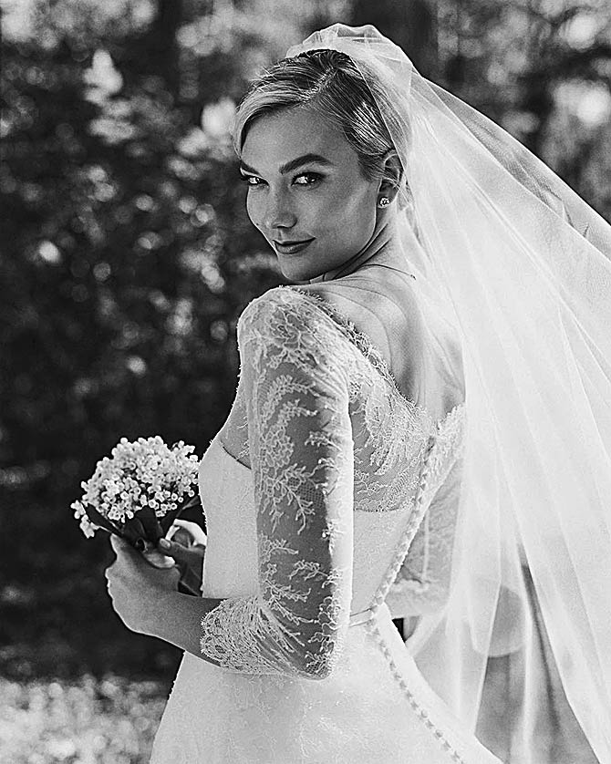 06f500c7c462ff3 Dressed in a custom Dior gown with lace sleeves and a strapless bodice,  Karlie look beautiful as a bride. Photographs: Courtesy Karlie Kloss /Instagram