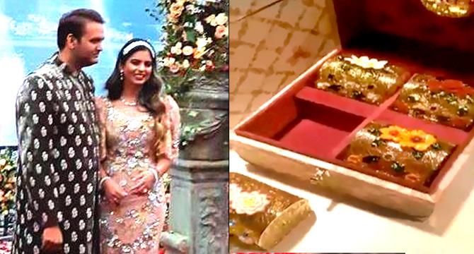 First Look Isha Ambanis Wedding Card Rediffcom Get Ahead