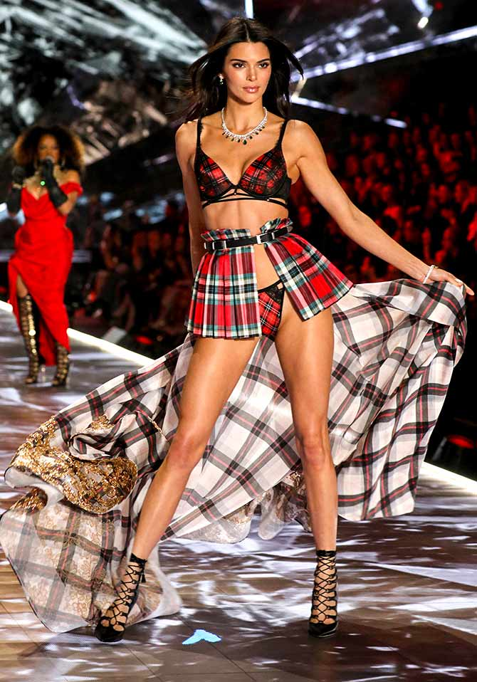 8a1af9cebe4c Kendall Jenner cuts a sexy figure in a red and black plaid outfit with gold  detailing on her train. Photograph: Thomas Concordia/Getty Images