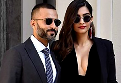 Latest News from India - Get Ahead - Careers, Health and Fitness, Personal Finance Headlines - Cleavage-baring Sonam goes sexy for Armani