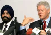 Former US President Bill Clinton addreses the press as Chief Executive Officer of Ranbaxy Labotaries Ltd D.S. Brar (L) looks on in New Delhi on Friday. Photo: Prakash Singh/AFP/Getty Image