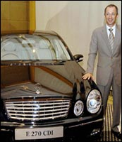 Daimler-Chrysler India CEO Hans Michael Huber with the newly launched Mercedes Benz E270 CDI. Photo: Prakash Singh/AFP/Getty Images
