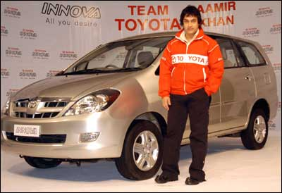 Toyota Kirloskar Motor on Wednesday signed leading Bollywood actor Aamir Khan as brand ambassador to promote its utility vehicle Innova in India. Photograph: Arun Patil
