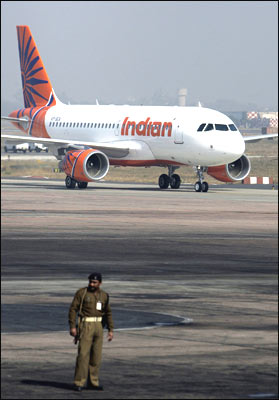 Indian Airlines' -- now renamed Indian -- new Airbus A-319 aircraft arrives at the Indira Gandhi International Airport in New Delhi on Wednesday. IA plans to buy 43 aircraft, including A-319s, A-320s and A-321s from European major Airbus Industries. Photogprah: Prakash Singh/AFP/Getty Images