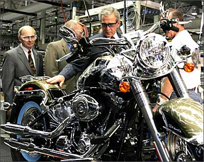 US President George W Bush at the Harley-Davidson assembly plant in York, Pennsylvania, along with Jim Ziemer (L), President and CEO of Harley-Davidson, Inc. Photograph: Tim Sloan / AFP / Getty Images