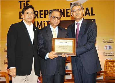 N R Narayan Murthy, co-founder and chairman of the board, Infosys Technologies, gets TiE Entrepreneurship Award from Apurv Bagri (right), chairman, TiE Global, and Shridhar Iyengar (left), president, TiE Global.
