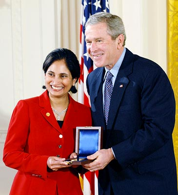 Padmasree Warrior, executive vice president and chief technology officer, Motorola, accepting the 2004 National Medal of Technology Award from President George W Bush on behalf of her company at a ceremony in the East Room of the White House on February 13. Photograph courtesy: Motorola