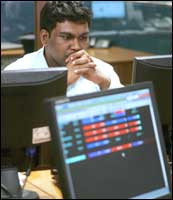 An Indian stockbroker keeps watch on his monitor as Indian stock market plunged by 826 points to 11,391 on 18 May, 2006. Photograph: Sebastian D'Souza/AFP/Getty Images