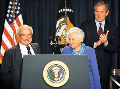 US President George W Bush honours Milton Friedman (L), the recipient of the 1976 Nobel Memorial Prize for Economic Science, on the occasion of his 90th birthday. Also seen is the Nobel laureate's wife Rose Friedman (C) during a tribute on May 9, 2002 in Washington, DC. Photograph: Tim Sloan/AFP/Getty Images