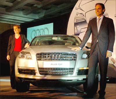 Audi executive director Andre Konsbruk (right) and product manager Sandra Berger pose with Audi Q7 sports utility vehicle unveiled in New Delhi on Friday. The SUV costs Rs 61 lakh. Photograph: Dijeshwar Singh/ Saab Pictures