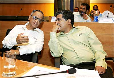 Infosys chief mentor and chairman N R Narayana Murthy (L) and current chief executive officer Nandan Nilekani discuss a point during a press conference in Bangalore on Friday. Nilekani will be co-chairman of the company from June 22, while S 'Kris' Gopalakrishnan will be the new Infy CEO. Photograph: Dibyangshu Sarkar/AFP/Getty Images