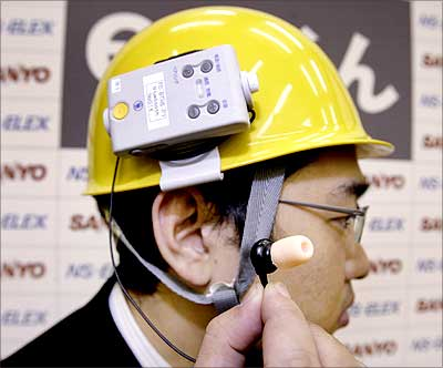e-Mimi kun, developed by NS-ELEX Co, works like a microphone and an earpiece by detecting air vibrations inside the ear. Photograph: Yoshikazu Tsuno/AFP/Getty Images