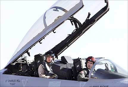 Tata Group chairman Ratan Tata (L) and US pilot Todd Nelson sit in the cockpit of a US made F-18 aircraft ahead of a flight during the third day of the Aero India 2007 air show at the Air Force Station, Yelahanka, in Bangalore, on Friday. Photograph: Dibyangshu Sarkar/AFP/Getty Images