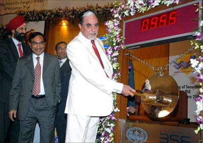 Zee Group's demerged firms Zee News and Wire and Wireless (India) Ltd were listed on the BSE on Wednesday. Zee chairman Subhash Chandra (right) rang the opening bell at the Bombay Stock Exchange. Also seen are (from left) Laxmi Narayan Goel, director, Zee News Group, and Rajnikant Patel, president, BSE. Photograph: Arun Patil