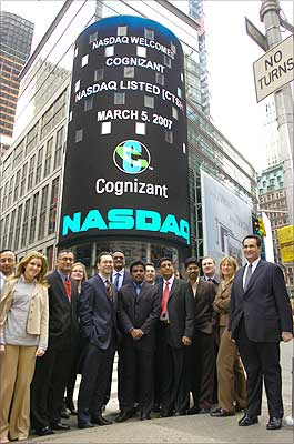 Cognizant Technology Solutions team, Nasdaq officials and traders after the Opening Bell ringing ceremony at the Nasdaq, Times Square, New York on Monday. Cognizant rang the bell from a remote location in Chennai to signal the beginning of trading on the Nasdaq. Photo: Paresh Gandhi