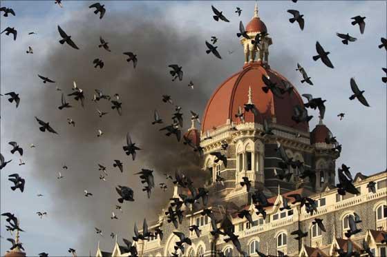 The resplendent Taj Hotel under siege by terrorists.   Photograph: Uriel Sinai/AFP/Getty Images