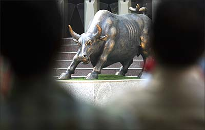 A bronze sculpture of a bull is seen on the premises of the Bombay Stock Exchange.