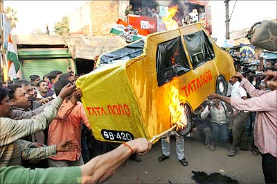Activists of the Trinamool Congress-led 'Krishi Jami Raksha Committee' burn an effigy of the Tata Nano during a demonstration in Singur, 30 kms north of Kolkata, where the construction of the Nano car factory is in process. Photograph: STRDEL/AFP/Getty Images