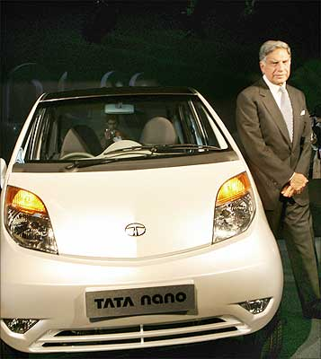 Tata Group chairman Ratan Tata poses with the Tata 'Nano' car during the launch of the world's cheapest car at $2,500 or Rs 1 lakh, in New Delhi, on January 10. Photograph: Raveendran/AFP/Getty Images