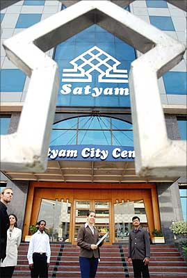 Employees of Satyam group standing out side the city centre in Hyderabad