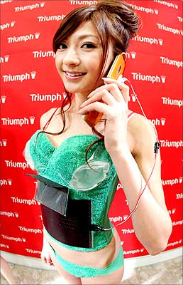 A mobile phone is charged by the lingerie maker Triumph's new environment-friendly 'Photovoltaic-Powered Bra' at Tokyo Ryutsu Center on May 14, 2008 in Tokyo, Japan. | Photograph: Junko Kimura/Getty Images