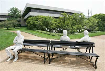 A sculpture called 'Three People on Four Benches' sits in front of Pepsico's world headquarters