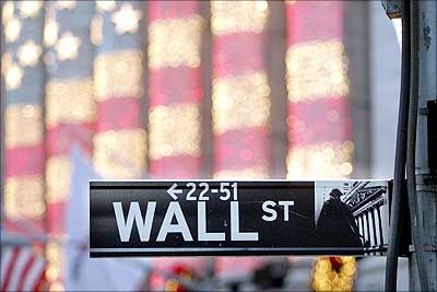 Image: A Wall Street sign is seen in front of the New York Stock Exchange. | Photograph: Mario Tama/Getty Images