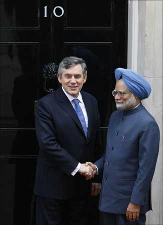 British Prime Minister Gordon Brown (L) greets Indian Prime Minister Manmohan Singh outside 10 Downing Street in London on Wednesday. | Photograph: Phil Noble/Reuters