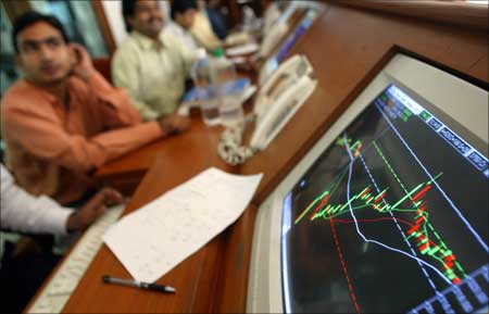 Indian stock brokers watch the key Sensex share index graph at a brokerage firm in Mumbai.