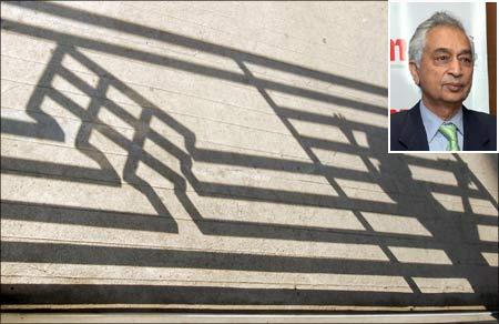 Shadows of Satyam Computer Services' logo seen at the entrance of a Satyam office building. (Inset) Tech Mahindra CEO Vineet Nayar. | Photograph: Krishnendu Halder/Reuters