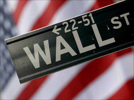 A street sign is seen in front of the New York Stock Exchange on Wall Street in New York.