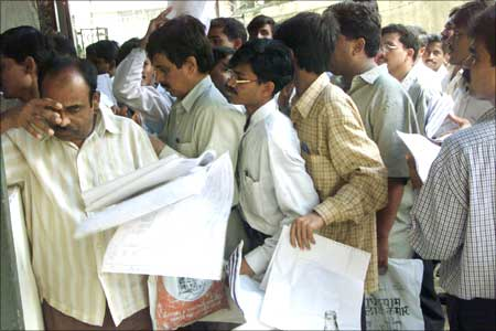 Tax payers queue up to file their income tax returns in Mumbai. Photograph: Reuters