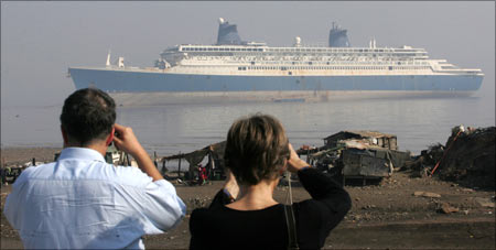 IMO members take pictures of the ship Blue Lady at the Alang shipyard