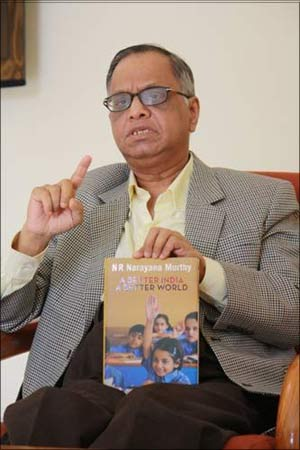 Narayana Murthy with his book at the Infosys guest house in New Delhi. | Photograph: Rajesh Karkera