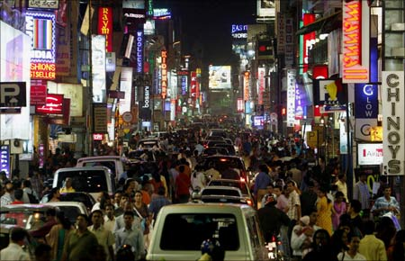 A view of a crowded street in Bangalore. | Photograph: Stringer/Reuters