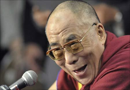 Exiled Tibetan spiritual leader the Dalai Lama laughs during a news conference in Santa Barbara, California. | Photograph: Phil Klein/Reuters