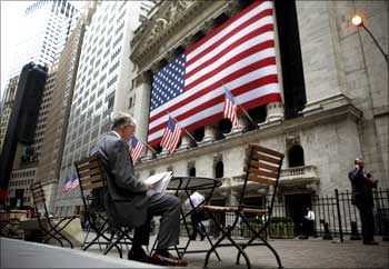 A man reads outside the New York Stock Exchange.