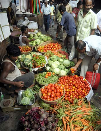 Customers purchase vegetables at a wholesale market in Agartala.