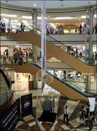 Image: People stroll a mall in Mumbai. Photograph: Punit Paranjpe/Reuters